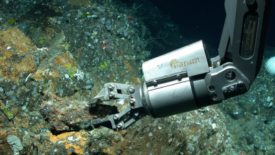 The manipulator of the diving robot MARUM-QUEST takes a geological sample at a depth of 530 meters northwest of the Azores island of São Miguel.
