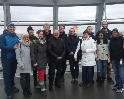 The group of visitors of the Bremen Max Planck Institute for Marine Microbiology in the dome of the Berlin Reichstag building.